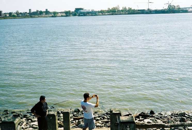 Two guys on the river front.